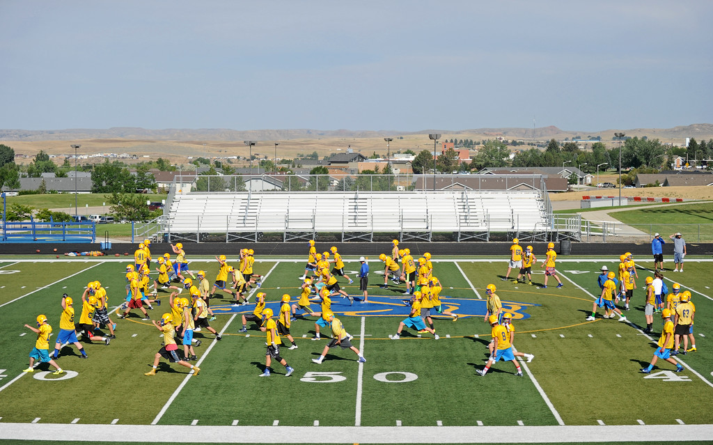 The Sheridan High School football team warms up at the start of practice on Monday, August 8 at Homer Scott Field. Monday was the first official practice day of the season for SHS and the rest of Wyoming's 4A teams. Mike Pruden | The Sheridan Press