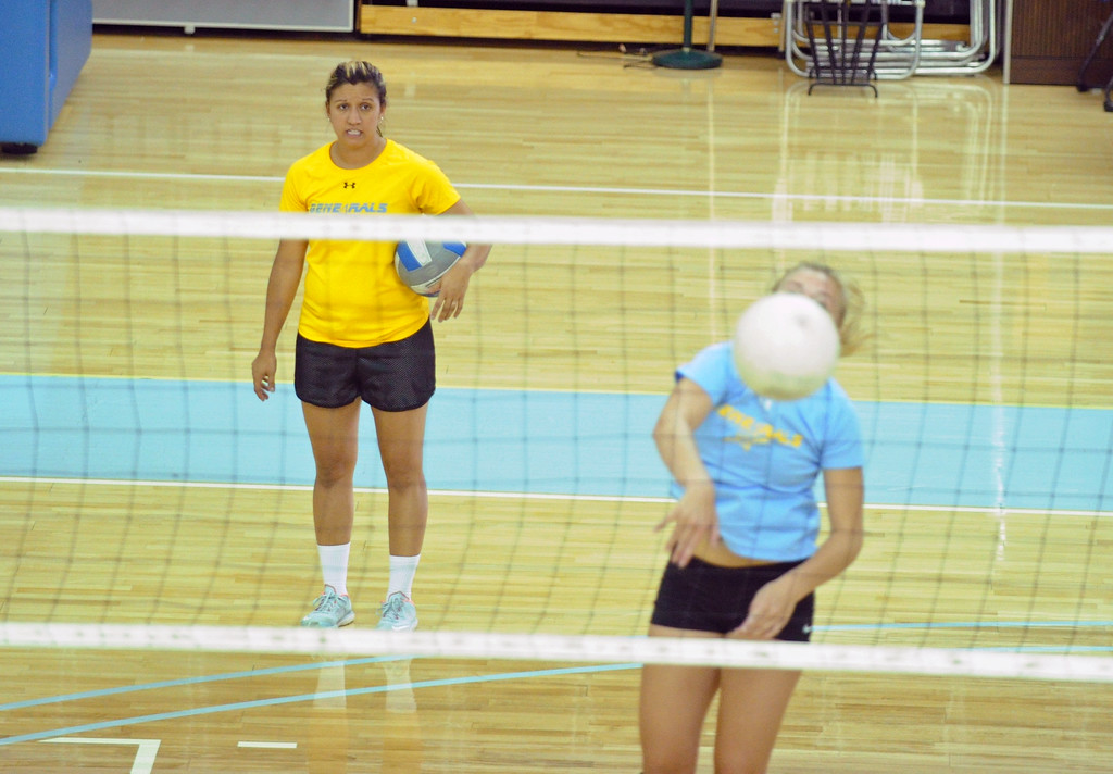Sheridan College head volleyball coach Jen Stadler looks on as her team runs through a hitting drill during practice on Thursday, August 11 at the Bruce Hoffman Golden Dome. Mike Pruden | The Sheridan Press