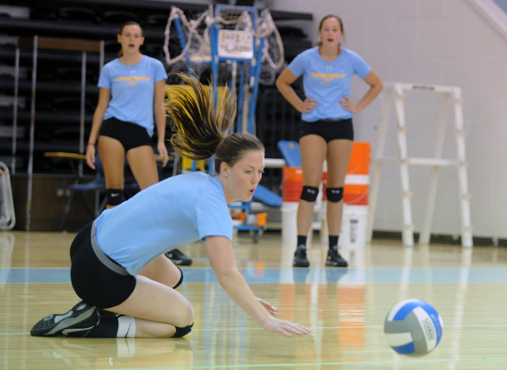 Miranda Gallagher dives to keep the ball off the ground during Sheridan College volleyball practice on Thursday, August 11 at the Bruce Hoffman Golden Dome. Mike Pruden | The Sheridan Press