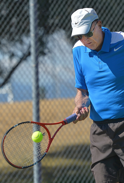 Justin Sheely | The Sheridan Press<br /> David Mullinax returns the ball during the Mullinax Tennis Doubles tournament Saturday at Sheridan High School.