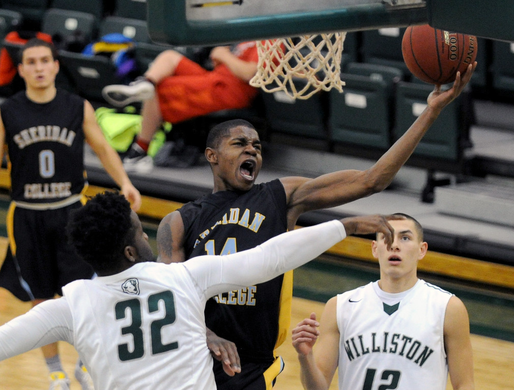 Xavier Jackson lays the ball up between two Williston State defenders on Friday, Dec. 9 at Williston State College in North Dakota. Mike Pruden | The Sheridan Press