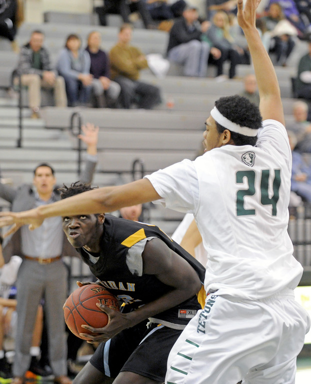 Elhadji Dieng eyes the basket as he makes a post move on Friday, Dec. 9 at Williston State College in North Dakota. Mike Pruden | The Sheridan Press