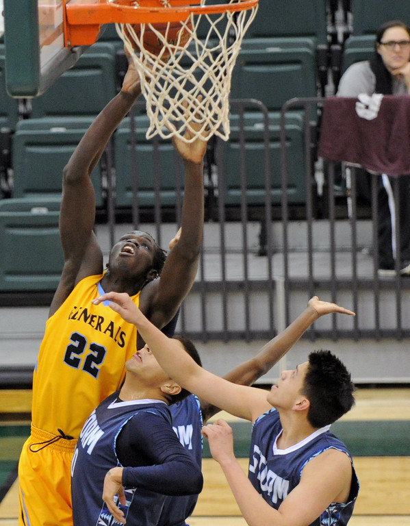 Elhadji Dieng, left, gets bumped as he puts up a layup Sheridan College's Dmonta Harris, left, goes up for a layup against Nueta Hidatsa Sahnish College on Saturday, Dec. 10 at Williston State College in North Dakota. Mike Pruden | The Sheridan Press