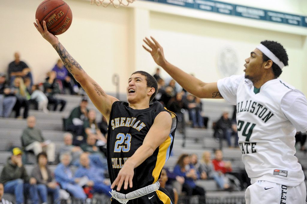 Channel Banks, left, lays the ball off the glass on Friday, Dec. 9 at Williston State College in North Dakota. Mike Pruden | The Sheridan Press