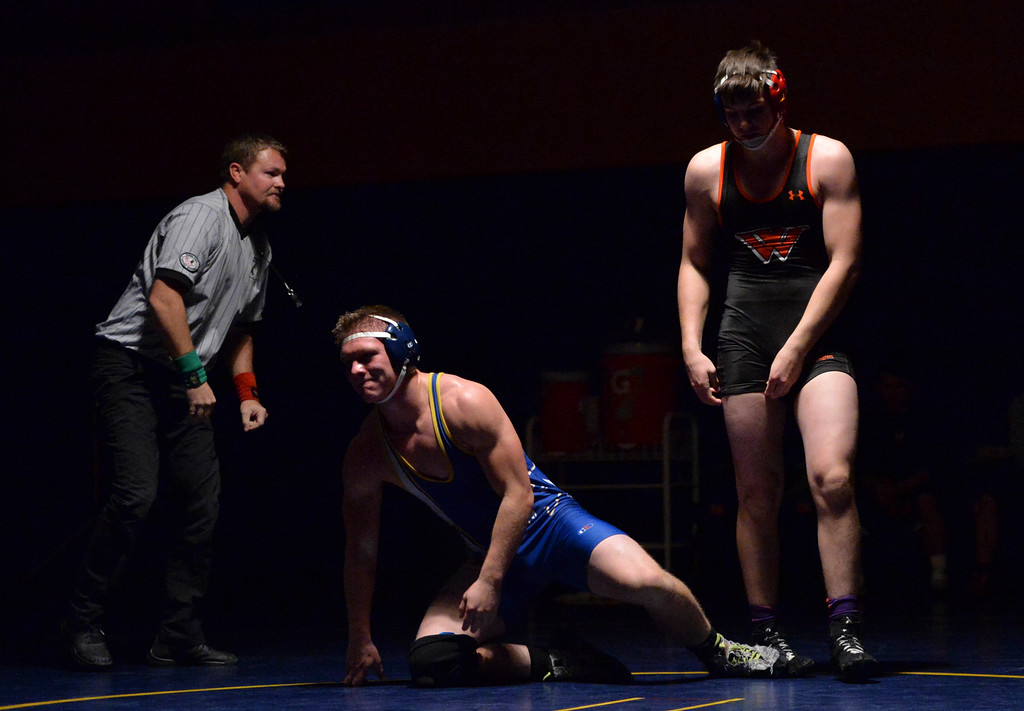 Justin Sheely | The Sheridan Press<br /> Sheridan's Jacek Aksamit is pinned by Worland's Quentin McBee during the Wrestling Dual Thursday at Sheridan High School.