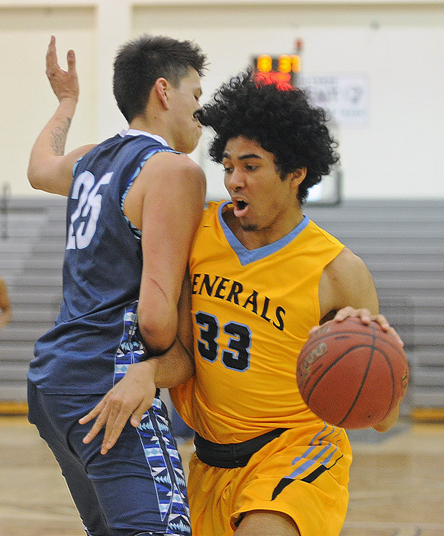Jeremiah Brown, right, gets bumped by Nueta Hidatsa Sahnish College's Jacob Knife as he drives to the basket on Saturday, Dec. 10 at Williston State College in North Dakota. Mike Pruden | The Sheridan Press