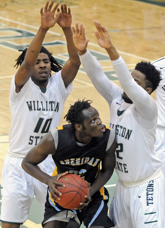 Elhadji Dieng gets trapped between two Williston State defenders on Friday, Dec. 9 at Williston State College in North Dakota. Mike Pruden | The Sheridan Press