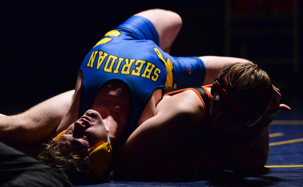 Justin Sheely | The Sheridan Press<br /> Sheridan's Carter Carter Mangus is pinned by Worland's Alex Beck during the Wrestling Dual Thursday at Sheridan High School.