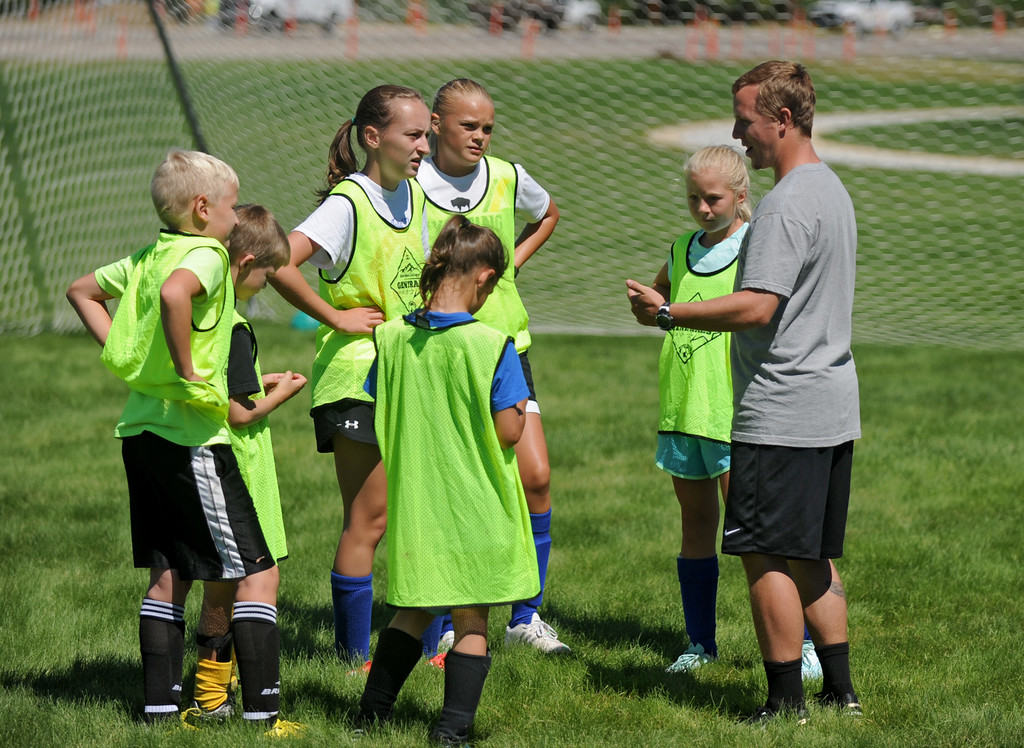 Sheridan College men's soccer coach Tim Starr, right, instructs participants at the the Sheridan College Premier Soccer Camp on Tuesday, July 12 at Sheridan College. Mike Pruden | The Sheridan Press