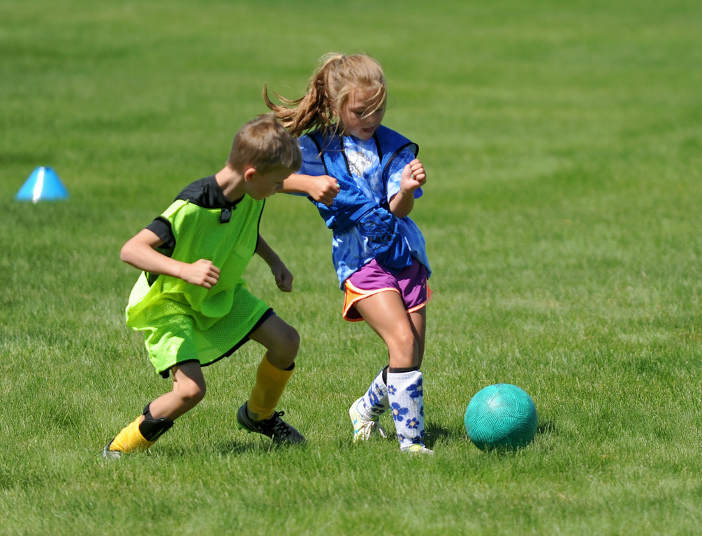 Noah Gorzalka, left, chases Avery Von Krosigk as she dribbles down field during the Sheridan College Premier Soccer Camp on Tuesday, July 12 at Sheridan College. Mike Pruden | The Sheridan Press