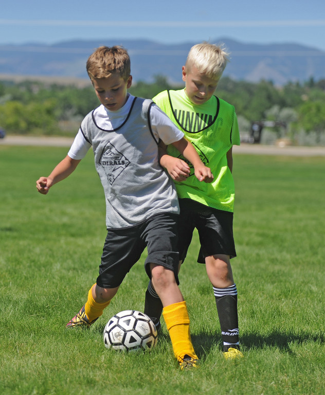 Drake Fisgus, left, holds off Wyatt Brown as the two battle for the ball during the Sheridan College Premier Soccer Camp on Tuesday, July 12 at Sheridan College. Mike Pruden | The Sheridan Press
