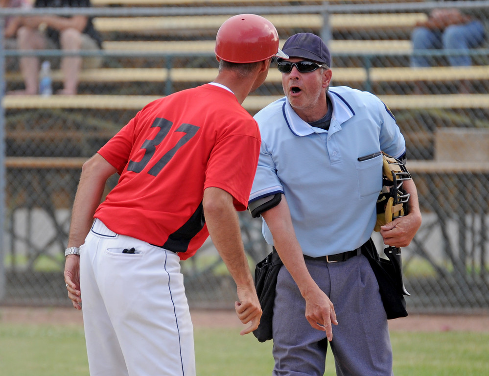 Umpire Keith Reichert, right, defends his call at the plate during a dispute with Gillette Roughriders coach Nate Perleberg on Tuesday, July 5 at Thorne-Rider Stadium. Perleberg disagreed after Reichert ejected a Gillette player for an illegal slide at home plate. Perleberg was also ejected. Mike Pruden | The Sheridan Press