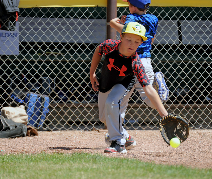 William Greer scoops a throw at first base during a whiffle ball game at the Troopers baseball camp on Thursday, July 7 at Thorne-Rider Stadium. Mike Pruden | The Sheridan Press