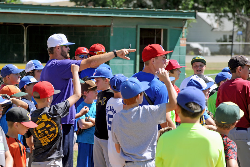 Sheridan Troopers head coach Ben Phillips, in white cap, points out instructions to participants at the Troopers baseball camp on Thursday, July 7 at Thorne-Rider Stadium. Mike Pruden | The Sheridan Press