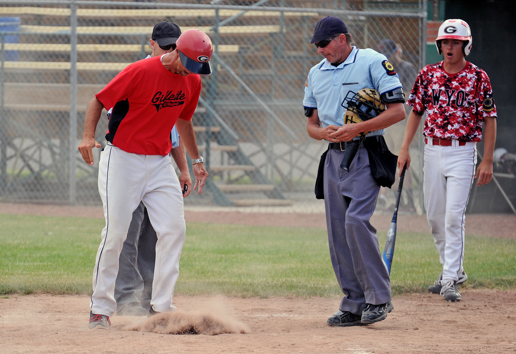 Gillette Roughriders coach Nate Perleberg, left, kicks dirt on home plate during an argument with umpire Keith Reichert on Tuesday, July 5 at Thorne-Rider Stadium. Perleberg disagreed after Reichert ejected a Gillette player for an illegal slide at home plate. Perleberg was also ejected. Mike Pruden | The Sheridan Press