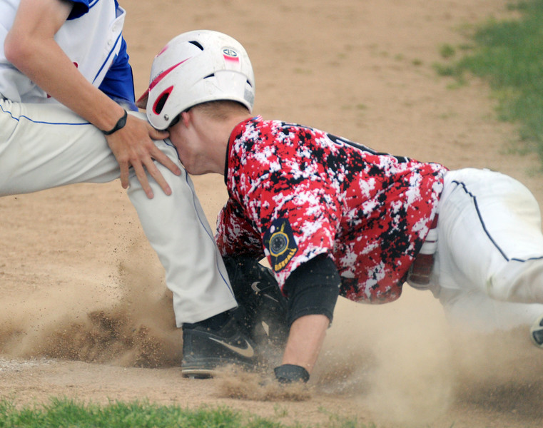 Gillette's Dillon Buckmeier smashes his face into the third baseman's knee while attempting a slide into the base during the Roughrider's matchup with the Sheridan Troopers on Tuesday, July 5 at Thorne-Rider Stadium. Mike Pruden | The Sheridan Press