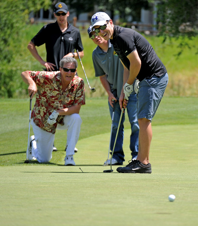 Nick Thom, right, smiles as he and his teammates watch his putt roll to the hole during the Sheridan Memorial Hospital Tournament on Friday, July 8 at the Powder Horn. Mike Pruden | The Sheridan Press
