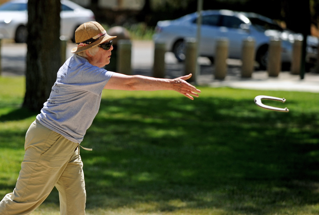 Sheridan's Betty McKinley lightly tosses a horseshoe during the Wyoming Senior Olympics on Thursday, August 4 at Kendrick Park. McKinley is also competing in the shot put during this week's Senior Olypics. Mike Pruden | The Sheridan Press