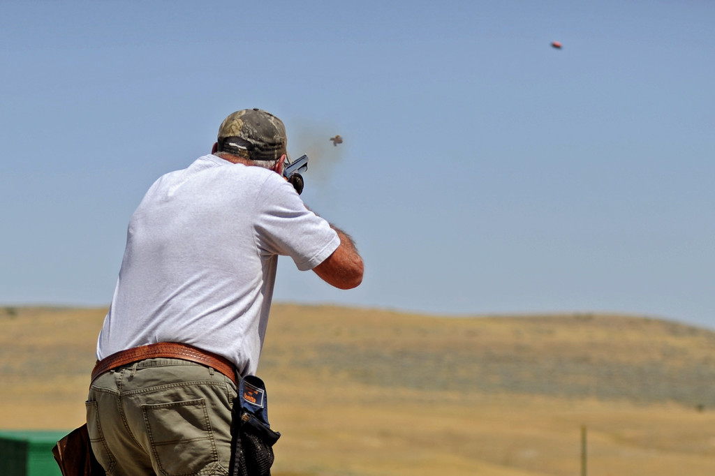 Edward Kimutis fires at a clay disc during the Wyoming Senior Olympics skeet shooting event on Friday, August 5 at the Sheridan County Sportsman Gun Club. Mike Pruden | The Sheridan Press