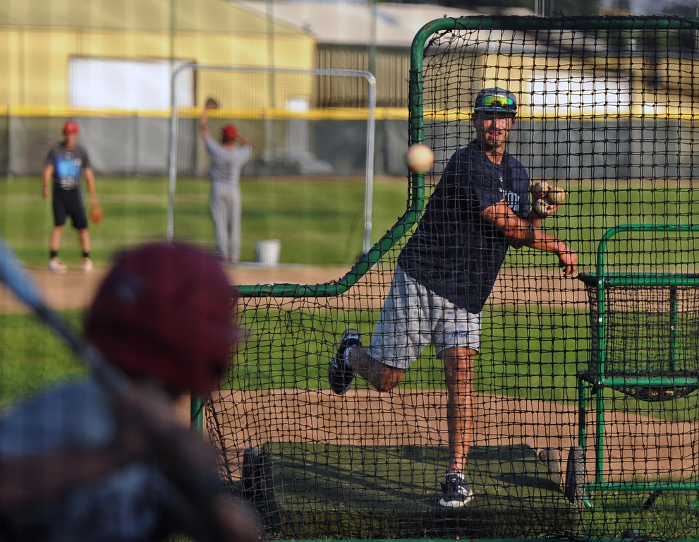 Sheridan Troopers assistant coach Isaac Carrel throws pitches during batting practice on August 1 at Thorne-Rider Stadium. The Troopers open the Northwest Regional Tournament Wednesday against the Billings Scarlets in Cheyenne. Mike Pruden | The Sheridan Press