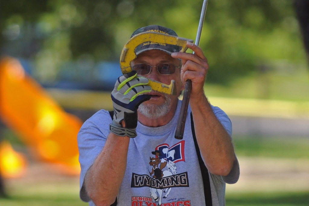 Gillette's Jack Kuhbacher lines up a throw during the horseshoes event at the Wyoming Senior Olympics on Thursday, August 4 at Kendrick Park. Kuhbacher won the gold medal in his age group and also won the unofficial overall championship. Mike Pruden | The Sheridan Press