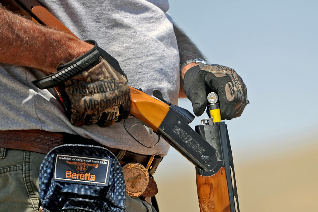 A competitor loads two new shells into his 20-gauge shotgun before the skeet shooting event at the Wyoming Senior Olympics on Friday, August 5 at the Sheridan County Sportsman Gun Club. Mike Pruden | The Sheridan Press