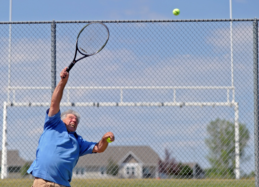 Bill Brooks reaches for a powerful serve during the mixed doubles tennis tournament at the Wyoming Senior Olympics on Saturday, August 6 at the Sheridan High School tennis courts. Mike Pruden | The Sheridan Press
