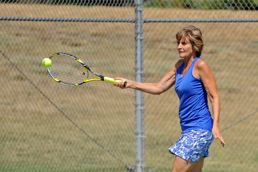Delece Faurot returns a serve during the mixed doubles tennis tournament at the Wyoming Senior Olympics on Saturday, August 6 at the Sheridan High School tennis courts. Mike Pruden | The Sheridan Press