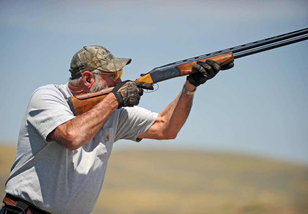 Edward Kimutis stares down the barrel of his 20-gauge shotgun during the skeet shooting event at the Wyoming Senior Olympics on Friday, August 5 at the Sheridan County Sportsman Gun Club. Mike Pruden | The Sheridan Press