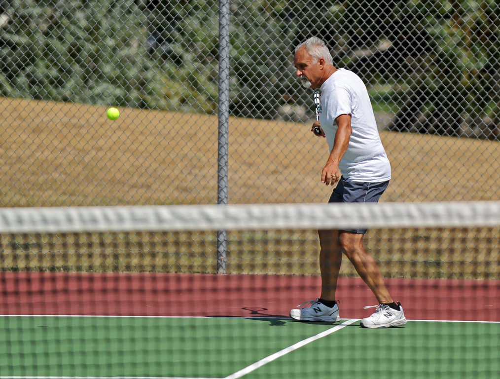 Bob Faurot hits a forehand during the mixed doubles tennis tournament at the Wyoming Senior Olympics on Saturday, August 6 at the Sheridan High School tennis courts. Mike Pruden | The Sheridan Press