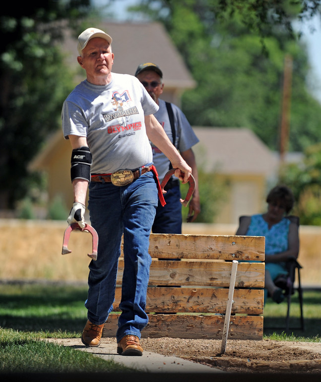 Bill Tighe steps into a throw during the horseshoes competition at the Wyoming Senior Olympics on Thursday, August 4 at Kendrick Park. Mike Pruden | The Sheridan Press