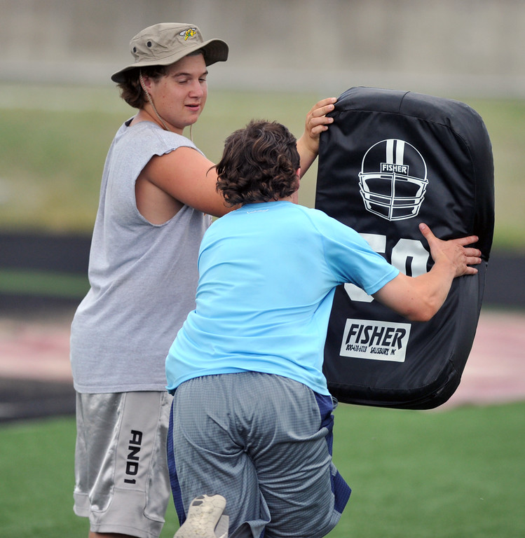 Big Horn's Jeremy Wolfe, left, holds a pad as teammate Andrew Ratty demonstrates a tackling drill during the Justin O'Dell Memorial football camp on Thursday, June 9 at Big Horn High School. Mike Pruden | The Sheridan Press
