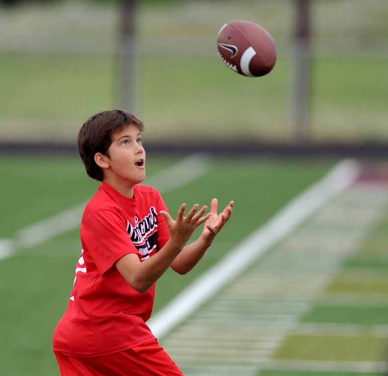 Cade Butler locks his eyes onto the football while running a route at the Justin O'Dell Memorial football camp on Thursday, June 9 at Big Horn High School. Mike Pruden | The Sheridan Press