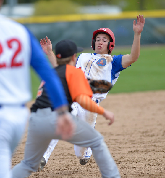 Mike Dunn | The Sheridan Press. <br /> Coy Steele slides into third base on a triple Saturday at Thorne Rider Field.