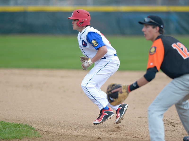 Mike Dunn | The Sheridan Press. <br /> Andrew Ratty,left, takes a lead off of first base Saturday at Thorne Rider Field.