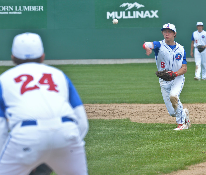 Mike Dunn | The Sheridan Press. <br /> Second basemen Jeff Shanor, right, throws the ball to first Saturday at Thorne Rider Field.