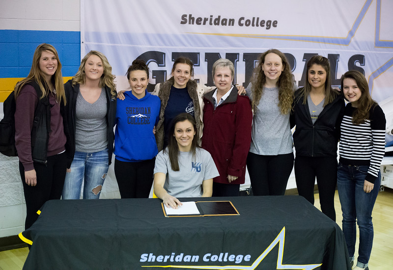 Sheridan College's Zuzana Talackova, seated, signed her letter of intent to continue her basketball career at Lander University in Greenwood, South Carolina. Talackova averaged 16.6 points and 5.9 rebounds in two years at Sheridan College and scored 1,029 total points. She was named to the All-Region IX first team in March.