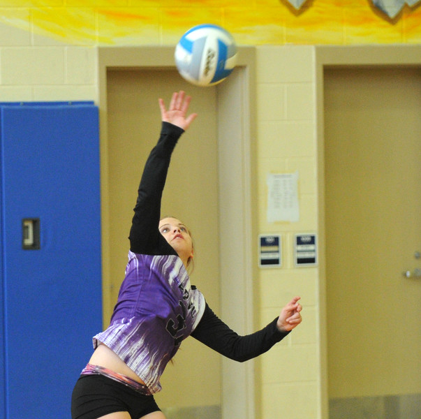 Powder River Volleyball Club's Jade Walker reaches for a serve during the Never Flinch volleyball tournament Sunday at Sheridan Junior High School.