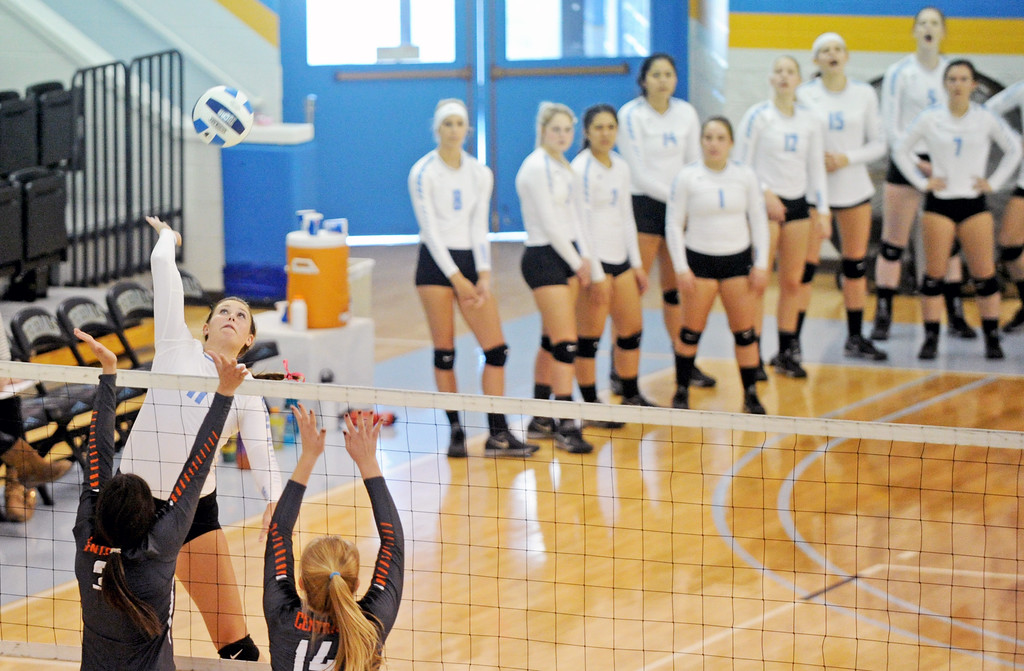 The Sheridan College volleyball team looks on as Ally Gates spikes the ball over the net against Central Wyoming on Saturday, Oct. 22 at the Bruce Hoffman Golden Dome. Mike Pruden | The Sheridan Press