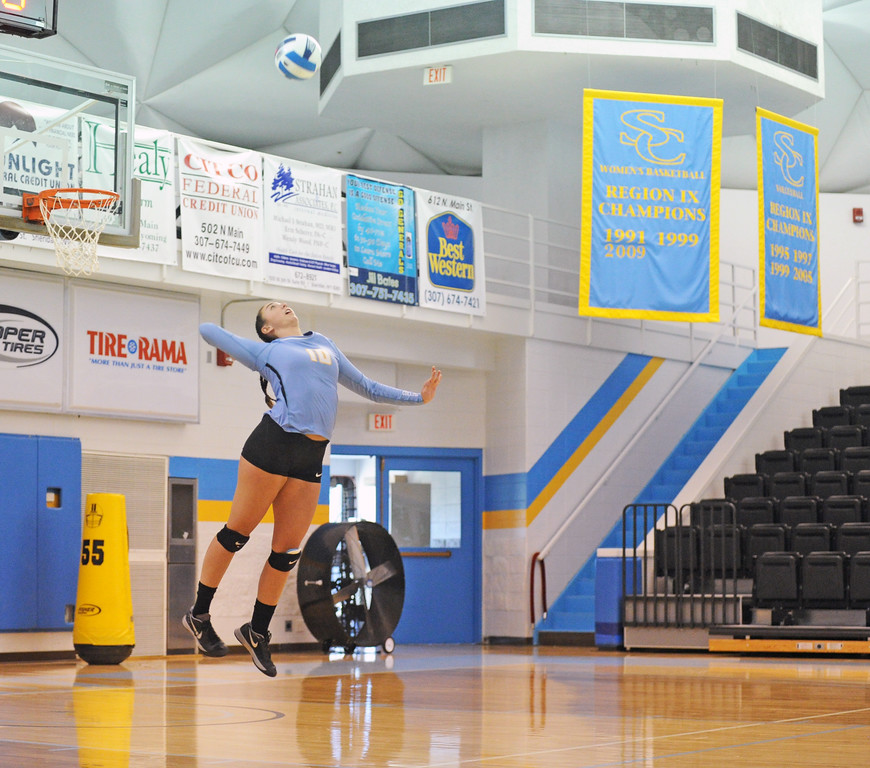 Dani Potter leaps for a serve against Central Wyoming on Saturday, Oct. 22 at the Bruce Hoffman Golden Dome. Mike Pruden | The Sheridan Press