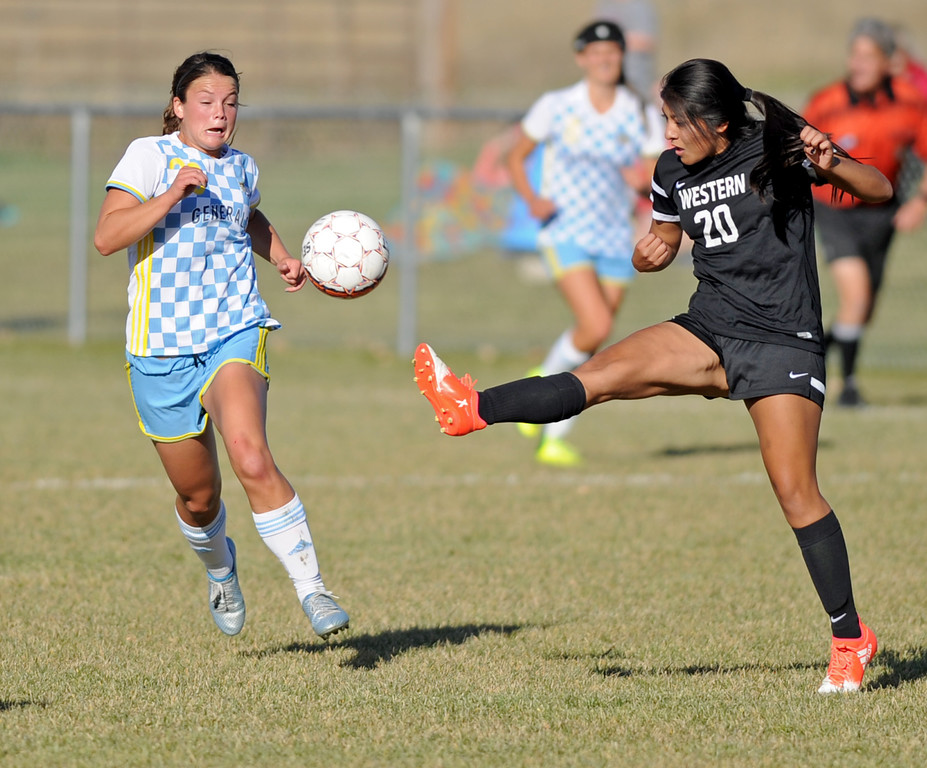 Sheridan College's Sarah Jones, left, chases down the ball as Western's Vanesa Ramirez kicks it away during the Region IX Tournament quarterfinal match on Saturday, Oct. 22 at Maier Field. Western defeated SC 2-1 in double overtime. Mike Pruden | The Sheridan Press