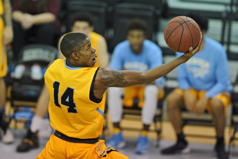 Xavier Jackson scoops in a finger roll during Sheridan College's win over Northeastern Junior College on Tuesday, Nov. 1 at the Bruce Hoffman Golden Dome. Mike Pruden | The Sheridan Press