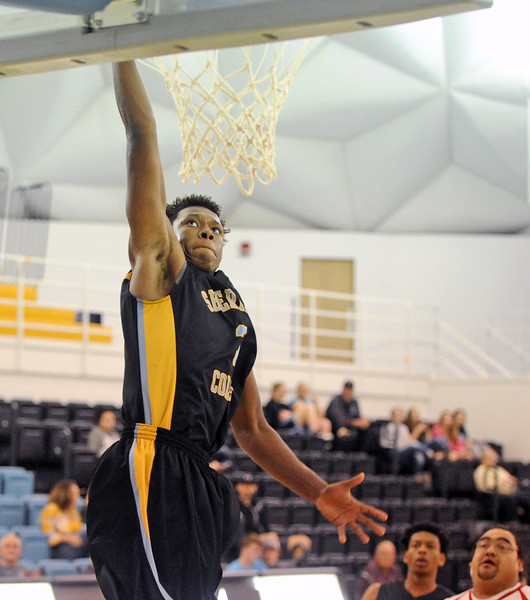 Sheridan College's Austin Sherrell dunks the ball against Fort Peck Community College on Friday, Nov. 5 at the Bruce Hoffman Golden Dome. Mike Pruden | The Sheridan Press