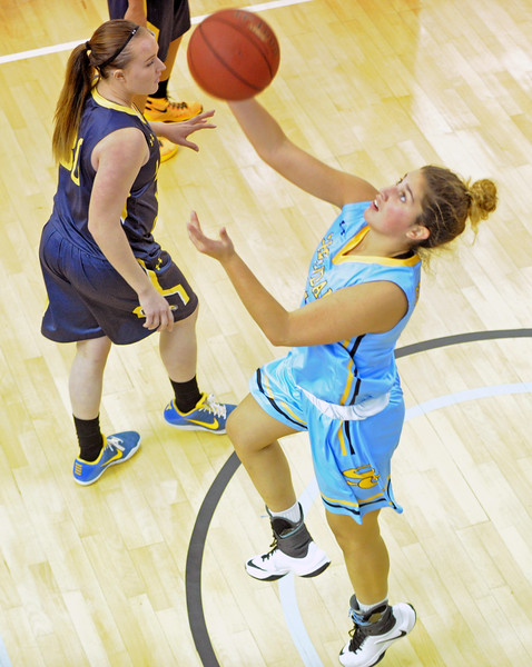 Sheridan College's Mar Colls goes up for a reverse layup against LCCC on Saturday, Nov. 5 at the Bruce Hoffman Golden Dome. Mike Pruden | The Sheridan Press