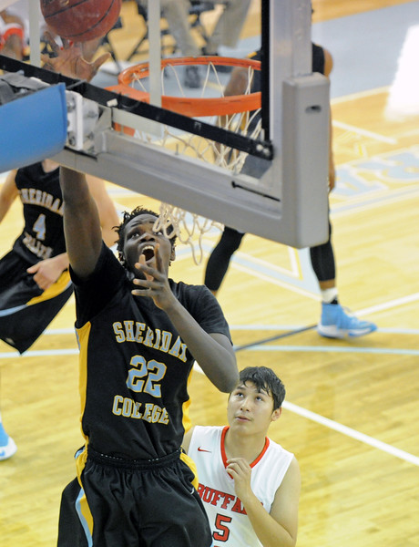 Elhadji Dieng drops in a layup against Fort Peck on Saturday, Nov. 5 at the Bruce Hoffman Golden Dome. Mike Pruden | The Sheridan Press