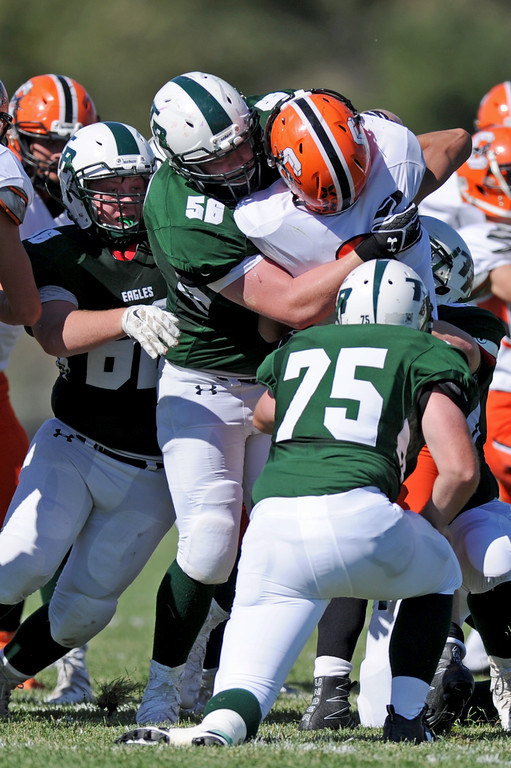 Tongue River linemen Kyler Heiling, left, and Mason Schroder (56) take down a Cokeville rusher on Saturday, Sept. 17 at Tongue River High School. Mike Pruden | The Sheridan Press