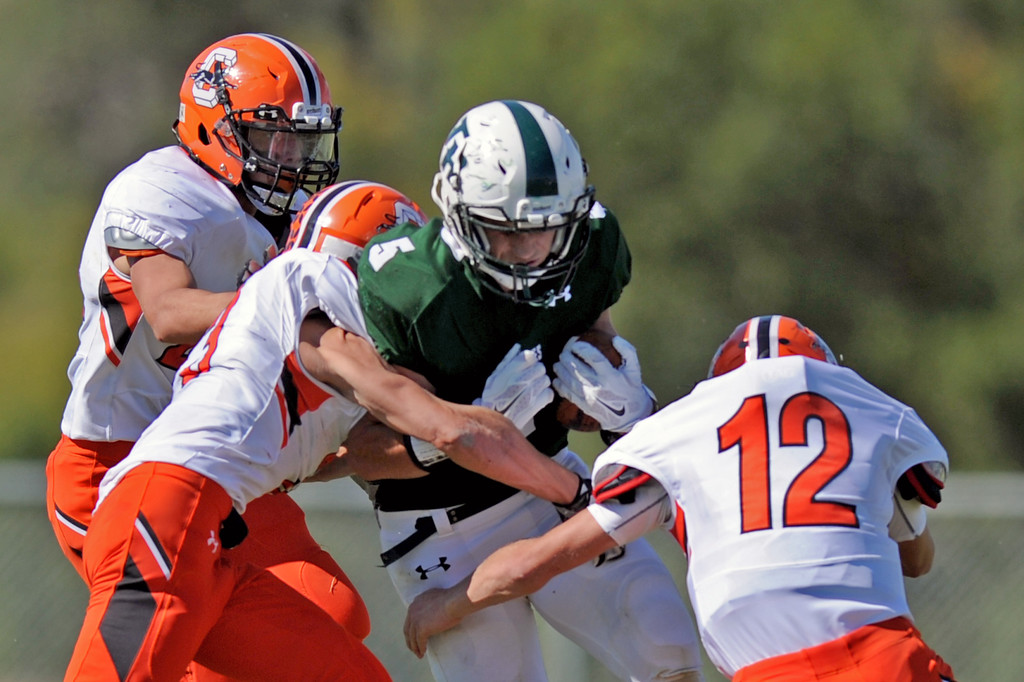 Tongue River quarterback Brennan Kutterer, center, tries to break through a group of Cokeville tacklers on Saturday, Sept. 17 at Tongue River High School. The Eagles lost 12-7. Mike Pruden | The Sheridan Press