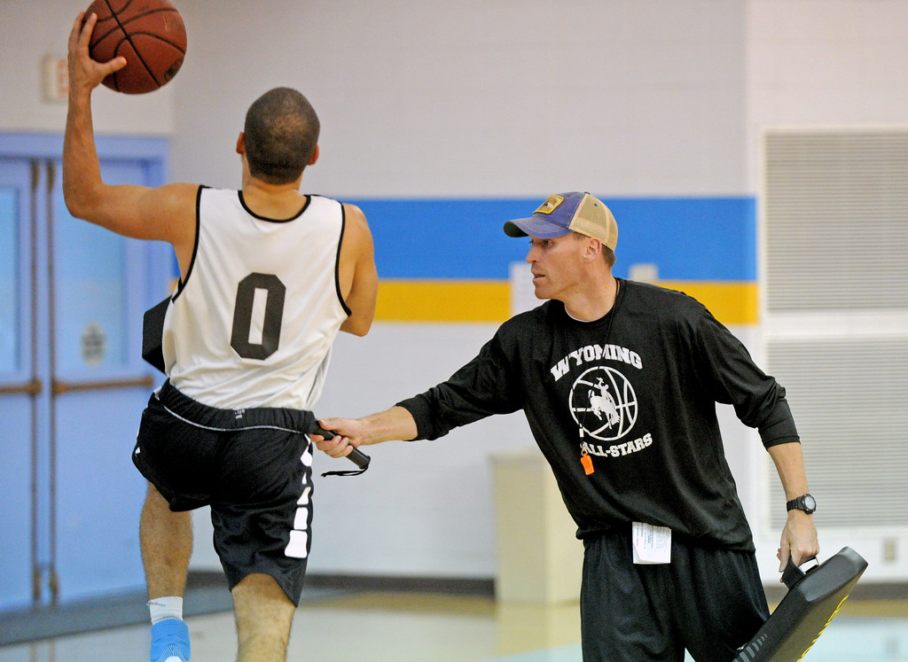 Sheridan College head basketball coach Matt Hammer, right, hits Celio Araujo with a pad during a layup drill at practice on Saturday, Oct. 1 at the Bruce Hoffman Golden Dome. Mike Pruden | The Sheridan Press