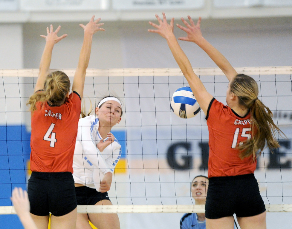 Sheridan College's Ashlee Purcella spikes the ball between two Casper blockers on Tuesday, Sept. 27 at the Bruce Hoffman Golden Dome. Mike Pruden | The Sheridan Press