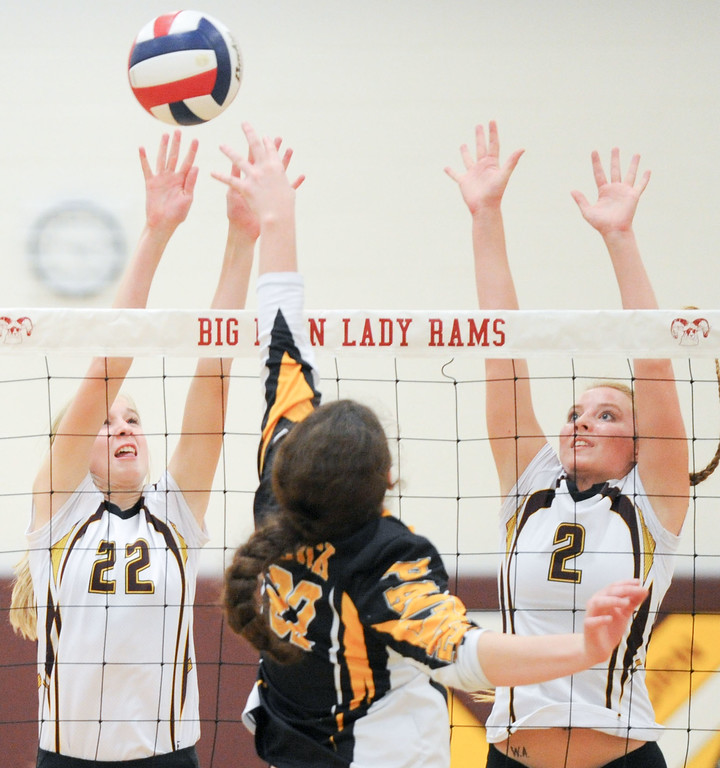 Mike Dunn | The Sheridan Press. <br /> Mary Nicholson, left, and Emily Blaney, right attempt to block a Wright hit Saturday against Wright.